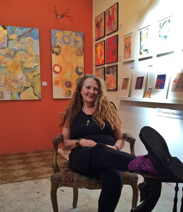 Orange wall, purple boots, and an open studio